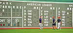 8 June 2012: Member of the Nationals walk the outfield in front of the Fenway Scoreboard prior to a game between the Washington Nationals and the Boston Red Sox at Fenway Park in Boston, MA. The Nationals defeated the Red Sox 7-4 in the opening game of their 3-game series. Mandatory Credit: Ed Wolfstein Photo