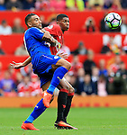 Danny Simpson of Leicester City clashes with Marcus Rashford of Manchester United during the Premier League match at Old Trafford Stadium, Manchester. Picture date: September 24th, 2016. Pic Sportimage