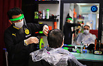 A Turkish barber wearing a protective face mask shaves a customer, amid concerns about the spread of the coronavirus disease (COVID-19), in Istanbul, Turkey, on May 11, 2020. Photo by Mahmoud abu Salama