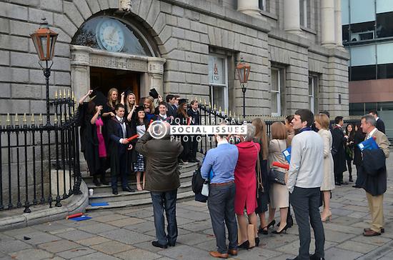 Medical graduates celebrating outside University College Dublin after their graduation ceremony. Ireland Nov 2016