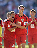 Fussball  1. Bundesliga  Saison 2013/2014  2. Spieltag VfB Stuttgart - Bayer Leverkusen     17.08.2013 JUBEL Bayer; Philipp Wollscheid (Mitte) umarmt Giulio Donati (li)