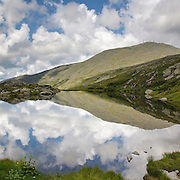 This is the image for July in the 2014 White Mountains New Hampshire calendar. Reflection of Mount Washington in Lakes of the Clouds along the Appalachian Trail in the White Mountains, New Hampshire USA. Purchase the calendar here: http://bit.ly/1audUBp .
