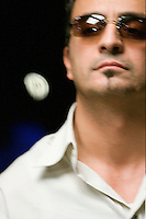 Professional Poker player Joseph Hachem, 39, from Australia, flips a $50, 000 dollar poker chip while waiting for the river card during competition at the final table of 9 players in the 36th annual World Series of Poker at Binion's Gambling Hall & Hotel on July 16, 2005 in Las Vegas, Nevada. Hachem won the tournament, and the first place prize of $7.5 million dollars. (Photo by Landon Nordeman)