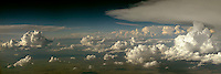 "Panoramic composite of clouds at 34,000 feet.  Shot taken over the great plains.  The pilot described the Cloud formation at right as a ""Thunderhead""."