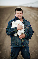 Zane Patterson (cq, age 12) holds a pile of cotton picked from his families cotton farm near Spearman, Texas, Tuesday, February 15, 2011. With the high price of cotton in recent years, many farmers in the area have switched to start farming cotton...Photo by Matt Nager