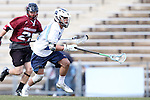 14 February 2015: North Carolina's Stephen Kelly (right) is chased by UMass's Tyler Weeks (22). The University of North Carolina Tar Heels hosted the University of Massachusetts Minutemen in a 2015 NCAA Division I Men's Lacrosse match. UNC won the game 20-8.