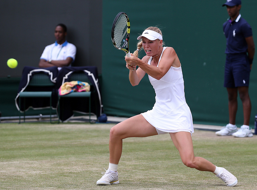 Caroline Wozniacki (DEN) [16] in action playing against Ana Konjuh (CRO) in their Ladies' Singles Third Round match today<br /> <br /> Photographer Kieran Galvin/CameraSport<br /> <br /> Tennis - Wimbledon Lawn Tennis Championships - Day 5 Friday 27th June 2014 -  All England Lawn Tennis and Croquet Club - Wimbledon - London - England<br /> <br /> &copy; CameraSport - 43 Linden Ave. Countesthorpe. Leicester. England. LE8 5PG - Tel: +44 (0) 116 277 4147 - admin@camerasport.com - www.camerasport.com.