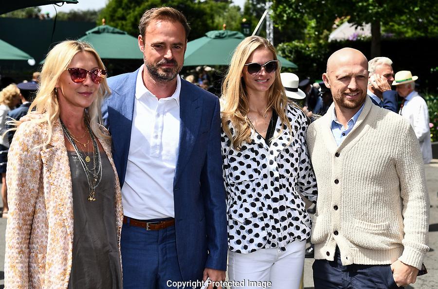 (l-r) Sophie Siegle (wife of Jamie Theakston), Jamie Theakston, Carolin Hauskeller (wife of Matt Dawson) and Matt Dawson