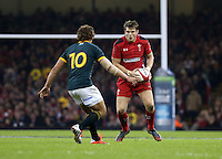 Pictured: Dan Biggar of Wales (R) against Pat Lambie of South Africa (L) Saturday 29 November 2014<br />