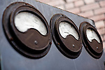 Three dials for taking measurements in disused warehouse in South Wales UK