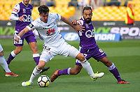 Marco Rossi holds off Diego Castro during the A-League football match between Wellington Phoenix and Perth Glory at Westpac Stadium in Wellington, New Zealand on Sunday, 12 November 2017. Photo: Dave Lintott / lintottphoto.co.nz