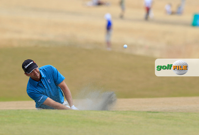 Retief Goosen (RSA) chips from a bunker at the 5th green during Thursday's Round 1 of the 2015 U.S. Open 115th National Championship held at Chambers Bay, Seattle, Washington, USA. 6/18/2015.<br /> Picture: Golffile | Eoin Clarke<br /> <br /> <br /> <br /> <br /> All photo usage must carry mandatory copyright credit (&copy; Golffile | Eoin Clarke)