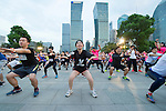 Warm up before the Bloomberg Square Mile Relay near the Huangpu River in Shanghai, China. Photo by Lucas Schifres / Power Sport Images