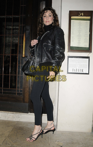 LONDON, ENGLAND - DECEMBER 09: Marie Helvin depart after an evening meal at 34 restaurant, 34 restaurant, South Audley St.., on December 09, 2013 in London, England, UK.<br /> CAP/CAN<br /> &copy;Can Nguyen/Capital Pictures