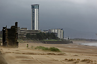 Pictured: Sand is blown on the beach by strong winnds in Swansea, Wales, UK. Thursday 20 September 2018<br /> Re: Heavy rain and strong winds brought by Storm Bronagh has hit parts of the UK.