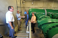 NWA Democrat-Gazette/MICHAEL WOODS &bull; @NWAMICHAELW<br /> Bill HagenBurger, plant engineer, (from left) Bill Watkins, board member, Chris Weiser, board member, Woody Bassett, board member, and Stacy Cheevers, Plant Manager, take a look around the pipe gallery at the North Intake facility at  Beaver Lake Thursday September 17, 2015 during a tour for the Beaver Water District board members.