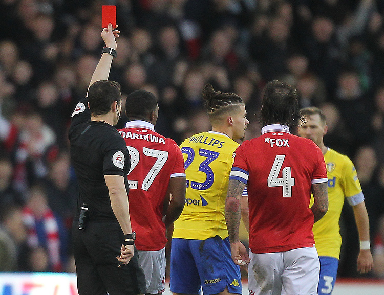 Leeds United's Kalvin Phillips is red carded by ref Darren England<br /> <br /> Photographer Mick Walker/CameraSport<br /> <br /> The EFL Sky Bet Championship - Nottingham Forest v Leeds United - Tuesday 1st January 2019 - The City Ground - Nottingham<br /> <br /> World Copyright © 2019 CameraSport. All rights reserved. 43 Linden Ave. Countesthorpe. Leicester. England. LE8 5PG - Tel: +44 (0) 116 277 4147 - admin@camerasport.com - www.camerasport.com