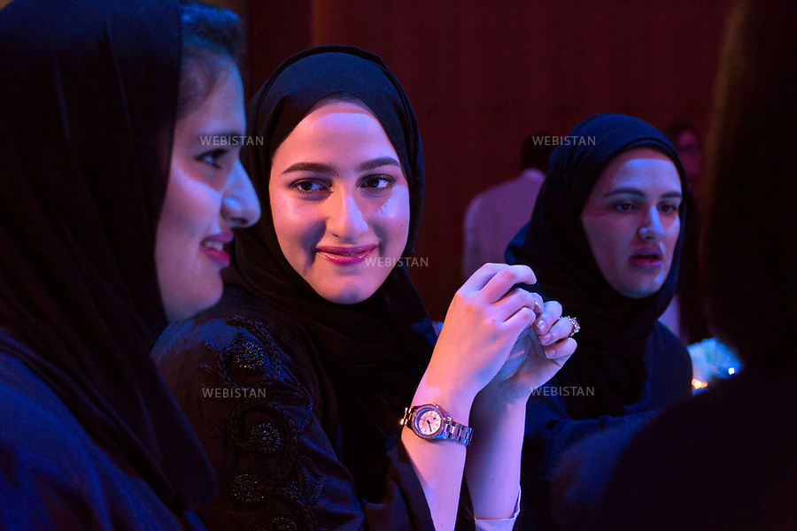 Qatar, Doha, Qatar National Convention Centre <br /> Opening night of the World Innovation Submit for Education 2012 (WISE): portrait of a young woman during the guests' dinner. <br /> Each year, WISE gathers experts coming from all around the world and more than 100 countries, all invited by the Qatar Foundation. As a real soft power tool of the emirate, WISE places education at the centre of the institutional, political and economic debate.<br /> Qatar is one of the Arab peninsular emirates, on the Persian Gulf shoreline. Bordered by Saudi Arabia, Qatar's economy relies on oil and gas. Being the world's fourth-largest gas exporter, gas remains the major driver of Qatar's economy. The emirate is governed by Sheikh Tamim bin Hamad Al Thani who became at the age of 33 Emir of Qatar on 25 June 25th, 2013 after his father's abdication. He is the youngest emir at the head of an Arab State.<br /> On June 5th, 2017, Saudi Arabia, the United Arab Emirates, Egypt, Bahrain, Yemen, Libya, Mauritania, the Maldives, and Mauritius broke off diplomatic relations with Qatar, accusing the emirate of supporting several terrorist groups. As its Gulf neighbours enforced the closure of all land, air and sea borders to Qatar, the country is quarantined.<br /> 