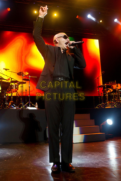 Pitbull (Armando Christian Perez).Concert in Krocus City Hall, Moscow, Russia..May 30th, 2012.on stage live gig performance performing music full length black suit sunglasses shades singing arm in air profile .CAP/PER/SB.©SB/PersonaStars/CapitalPictures