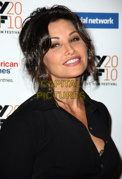 GINA GERSHON .World Premiere of 'The Social Network' during the 48th New York Film Festival at Alice Tully Hall, Lincoln Center on September 24, 2010 in New York City, New York, NY, USA, .24th September 2010..portrait headshot hair up  black shirt .CAP/ADM/PZ.©Paul Zimmerman/AdMedia/Capital Pictures.