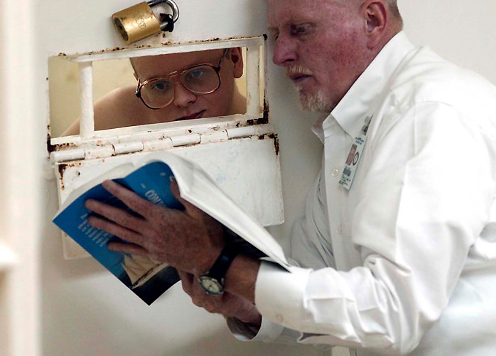 "Leonard Adams reads a passage of scripture to an inmate in the Kentucky State Penitentiary in Eddyville, Ky. Adams, once an inmate himself, returns two days a week as a volunteer prison chaplain.""A man can't be truly set free until he is spiritually set free"" says  Adams."