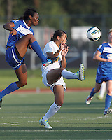Boston Breakers defender Kia McNeill (14) clears the ball beating Western New York Flash forward Samantha Kerr (4). In a National Women's Soccer League (NWSL) match, Boston Breakers (blue) tied Western New York Flash (white), 2-2, at Dilboy Stadium on August 3, 2013.