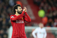 2nd January 2020; Anfield, Liverpool, Merseyside, England; English Premier League Football, Liverpool versus Sheffield United; Mohammed Salah of Liverpool  acknowledges the applause from the home supporters as he is withdrawn late in the second half - Strictly Editorial Use Only. No use with unauthorized audio, video, data, fixture lists, club/league logos or 'live' services. Online in-match use limited to 120 images, no video emulation. No use in betting, games or single club/league/player publications