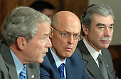 United States Secretary of the Treasury Henry Paulson, center, and US Secretary of Commerce Carlos Gutierrez, right, look on as US President George W. Bush speaks to the media regarding the economy prior to a Cabinet meeting in the Cabinet Room of the White House on October 15, 2008. <br /> Credit: Roger L. Wollenberg / Pool via CNP
