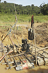 Water pump at an unregulated gold mining operation on the Brokopondo reservoir, Suriname.  The man-made lake was hastily created by flooding a vast acreage of jungle without any prior logging and evacuation of animals and is reputed to be polluted by mercury from the mines..