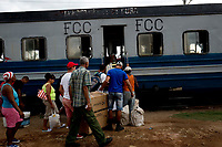 TRINIDAD, CUBA - MAY 10: Cuban passengers board a train at Trinidad train station to go Iznaga on May 10, 2018. in Cuba. Ferrocarriles de Cuba, is one of the oldest railroad around world, having opened its first route in 1837 with at least 17-mile long. Now the railway probably could cover more than 2,600 miles along the Island. (Photo by Eliana Aponte/VIEWpress)