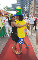 Germany, DEU, Dortmund, 2006-Jun-14: FIFA football world cup (USA: soccer world cup) 2006 in Germany; fans of the Brazilian football team dancing on the red carpet between the city and the world cup stadium.