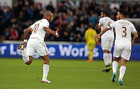 Andre Ayew of Swansea (L) celebrates his goal with team mate Neil Taylor during the Barclays Premier League match between Swansea City and Bournemouth at the Liberty Stadium, Swansea on November 21 2015