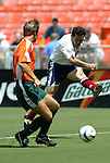 31 August 2004: Hugo Perez (right) takes a shot past Richard Gough (left). The MLS USA Legends and MLS World Legends tied 2-2 at RFK Stadium in Washington, DC in the Major League Soccer Sierra Mist Celebration Game honoring the 10th anniversary of the FIFA World Cup 94 held in the United States. The game featured current and former MLS players that participated in the 1994 World Cup and World Cup Qualifying, and it was held prior to the 2004 MLS All-Star game..