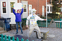 Carlos Arredondo, 57, (right) and his wife Melida Arredondo, 52, are seen in their front yard in Roslindale, Boston, Massachusetts, USA, on Sat., March 31, 2018. Arredondo is well known as the &quot;man in the cowboy hat&quot; who helped out in the aftermath of the Boston Marathon Bombing in 2013. Carlos is wearing a jacket that he has used to create a t-shirt design for when he runs the Boston Marathon later this year. Though he has run the race unofficially previously, this will be the first time he runs it &quot;legally,&quot; he says.<br /> <br /> Behind the couple is a memorial to their two sons,  Marine Lance Corporal Alexander Scott Arredondo and Brian Arredondo. Alex was killed while serving in Iraq in 2004, and Brian died by suicide in 2011. <br /> <br /> Carlos is wearing a mask and using a crutch as part of a joke between him and his therapist.