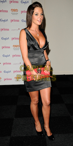 DANIELLE LLOYD .The Comfort Prima High Street Fashion Awards, Battersea Evolution Centre, Battersea Park, London, England. .September 11th, 2008.full length black dress red clutch bag cleavage skull brooch low cut plunging neckline .CAP/CAN.©Can Nguyen/Capital Pictures.