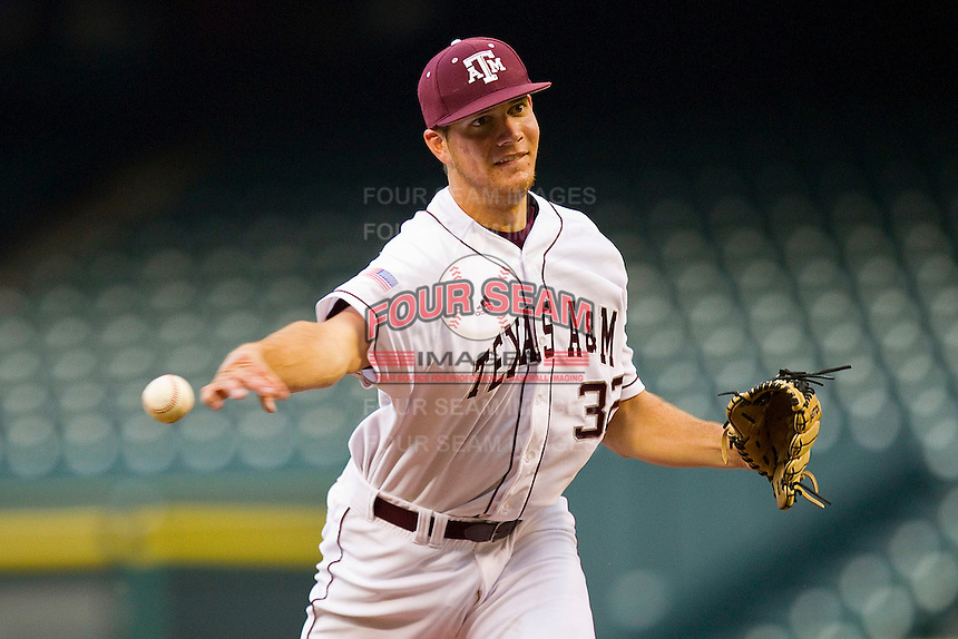 Kyle Martin #32 of the Texas A&M Aggies throws a pitch to the plate against the Utah Utes at Minute Maid Park on March 4, 2011 in Houston, Texas.  Photo by Brian Westerholt / Four Seam Images