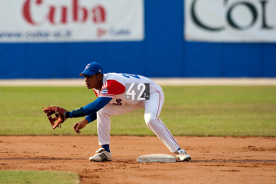 27 September 2009: Hector Olivera of Cuba is seen on defense during the 2009 Baseball World Cup gold medal game won 10-5 by Team USA over Cuba, in Nettuno, Italy.