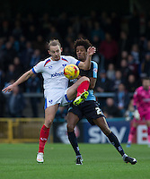 Adam McGurk of Portsmouth and Sido Jombati of Wycombe Wanderers battle for the ball during the Sky Bet League 2 match between Wycombe Wanderers and Portsmouth at Adams Park, High Wycombe, England on 28 November 2015. Photo by Andy Rowland.