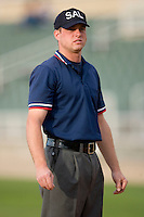 Umpire Joseph Born handle the calls on the bases during the South Atlantic League contest between the Lakewood BlueClaws and the Kannapolis Intimidators at Fieldcrest Cannon Stadium May 16, 2009 in Kannapolis, North Carolina. (Photo by Brian Westerholt / Four Seam Images)