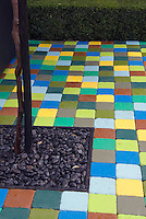 37678 Multi-colored patio pavers, with inset for tree, with yew shrubbery