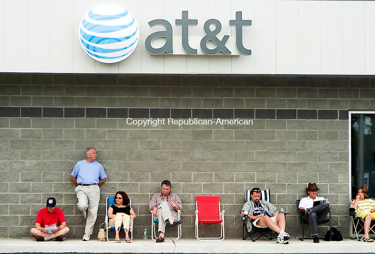 TORRINGTON, CT- 29 JUNE 2007- 062907JT02-<br /> Customers sit in line outside of the AT&amp;T/ Cingular store Friday afternoon in Torrington waiting for the launch of the new Apple iPhone as employees had closed the store from 4:30 to 6 p.m. to prepare for the rush.<br /> Josalee Thrift Republican-American