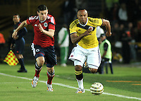 BOGOTA – COLOMBIA -  23-05-2014: James Rodriguez (Izq.) y Camilo Zuñiga (Der.) jugadores de la Selección Colombia de futbol disputan el balón, en partido durante fiesta de despedida en el estadio Nemesio Camacho el campin de la ciudad de Bogota, Colombia parte hacia La copa Mundo Brasil 2014. / James Rodriguez (L) and Camilo Zuñiga (R) plyers of Colombia soccer team struggles for the ball in a math during a farewell party at the stadium Nemesio Camacho El Campin stadium in Bogota city, Colombia travels to the World Cup Brazil 2014. Photo: VizzorImage / Luis Ramirez / Staff.