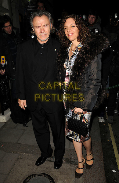 DAPHNA KASTNER & HARVEY KEITEL .Finch and Partners Pre-Bafta Party held at Mark's Club, Mayfair, London, England..February 9th 2008.full length black suit married husband wife brown fur collar puffer jacket .CAP/CAN.©Can Nguyen/Capital Pictures