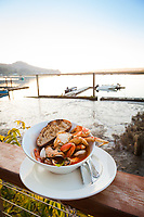 Cioppino on the Outdoor deck, overlooking Nehalem Bay at the Salmonberry Saloon in Wheeler, Oregon