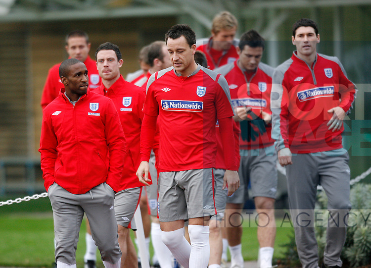 England's John Terry chats with Jermaine Defoe during training