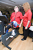 Man with prosthetic limb using the exercise bike at a gym,