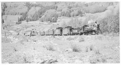 Rocky Mountain Railroad Club Excursion 1951 near curve at Trout Lake outlet.  Train consist is cabooses #0400 &amp; #0401, 3 gondolas and &quot;Edna&quot;.<br /> RGS  Trout Lake, CO  Taken by Mead, Edgar T. - 9/2/1951
