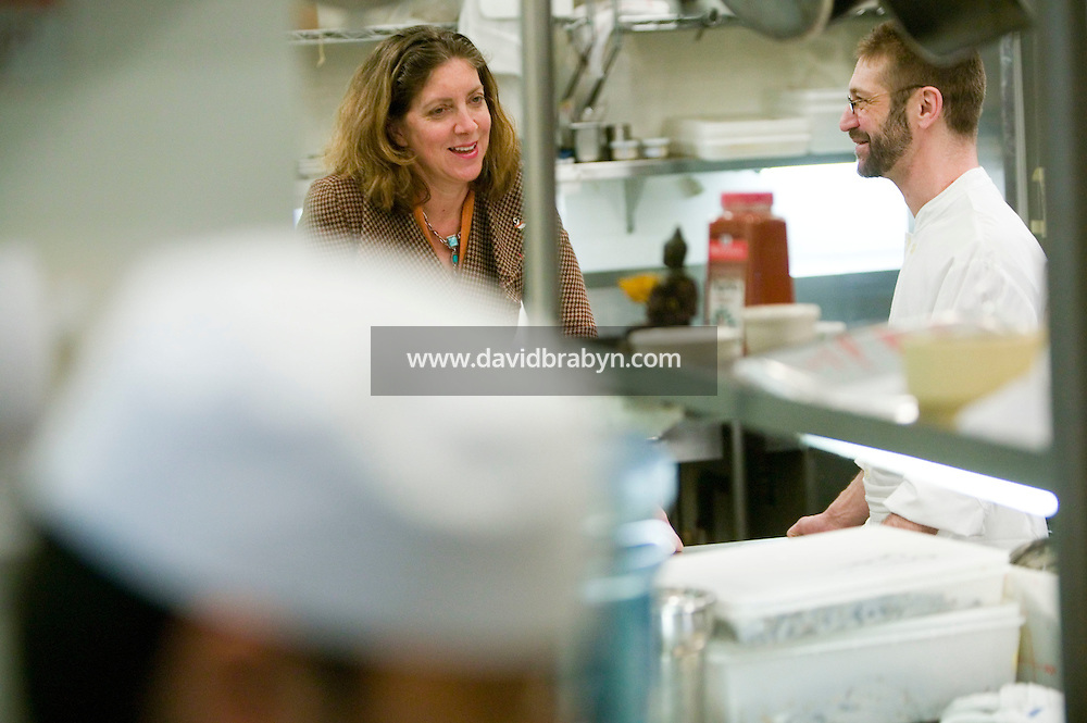 19 December 2006 - New York City, NY - Ariane Daguin (C), owner of food distribution company D'Artagnan, talks to her client chef David Waltuck in the kitchen of his restaurant Chanterelle in New York City, USA 19 December 2006.