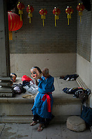 A master prepares to perform the traditional Big Head Buddha dance in front of the ancient ancestral temple at Yanqiao village in Nanhai district of Foshan city, Guangdong province, November 8, 2011.