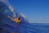 Girl on a body board at Velzyland, North Shore of Oahu
